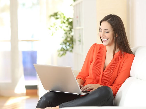 Female watching videos on laptop